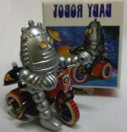 baby robot on trike windup tin toy