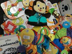 collection of baby toys rattles teethers etc